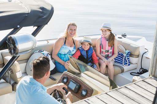 Family smiling while in a boat together